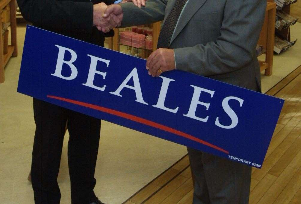 L to R: Nigel Beale, Chairman receives the new name plaque that will cover the old Bentalls sign by Piers Bentalls from the Bentalls family previous owners of the familiar Tonbridge department store.(26619407)