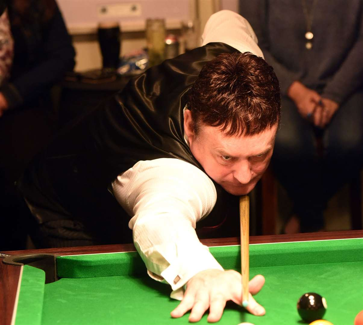 Jimmy White playing an exhibition match