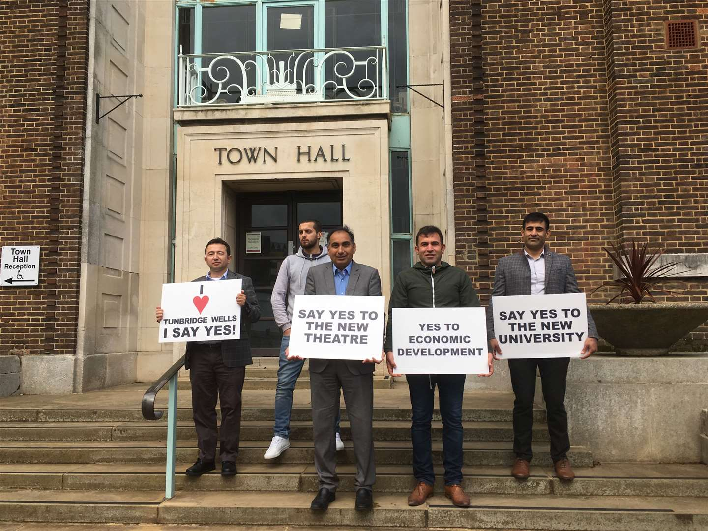 Five supporters stand outside Tunbridge Wells' Town Hall