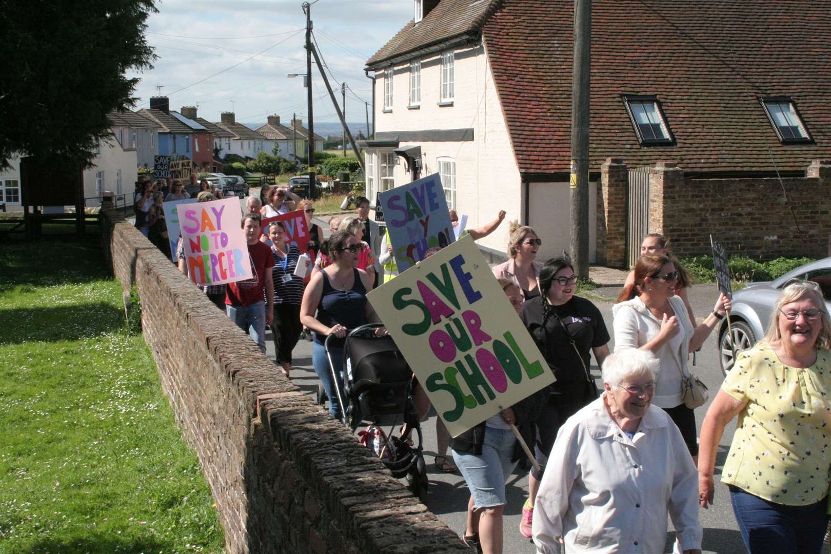 Protestors march from Stoke Primary Academy to Allhallows Primary Academy to rally against merger plans (13238487)