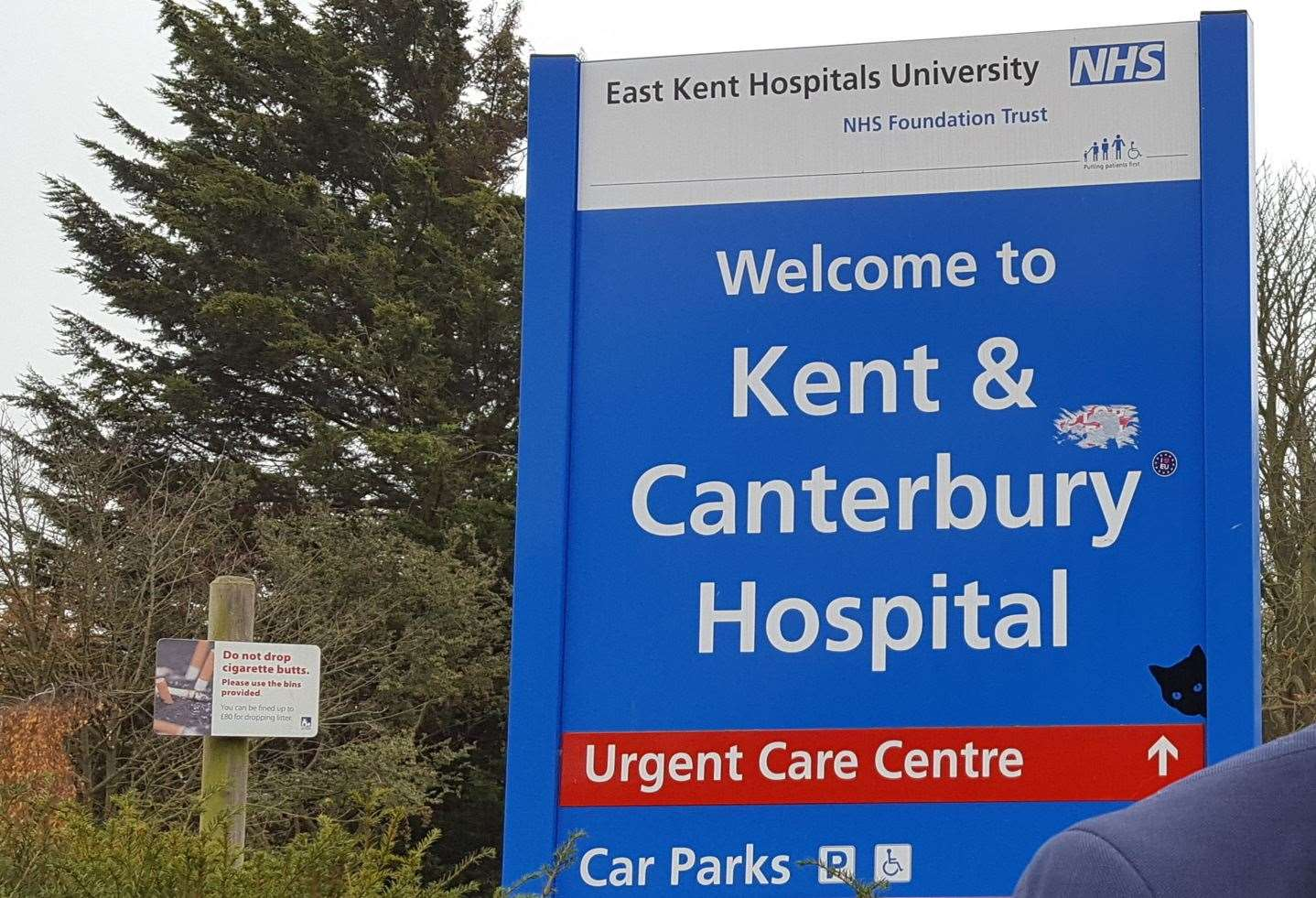 A black cat on the sign at the Kent and Canterbury Hospital