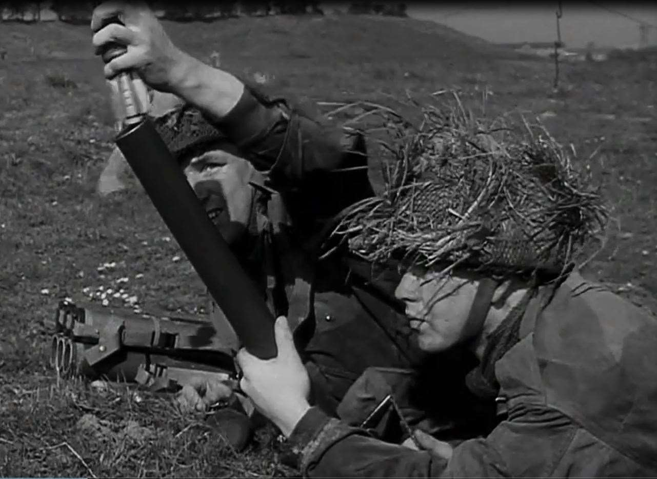 National Servicemen training with a mortar