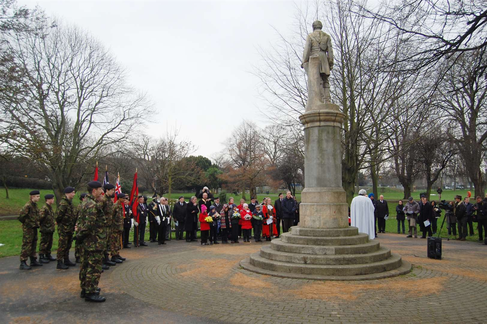 People gather at a service to commemorate the death of General Charles Gordon at the statue erected in his honour in the Fort Gardens, Gravesend