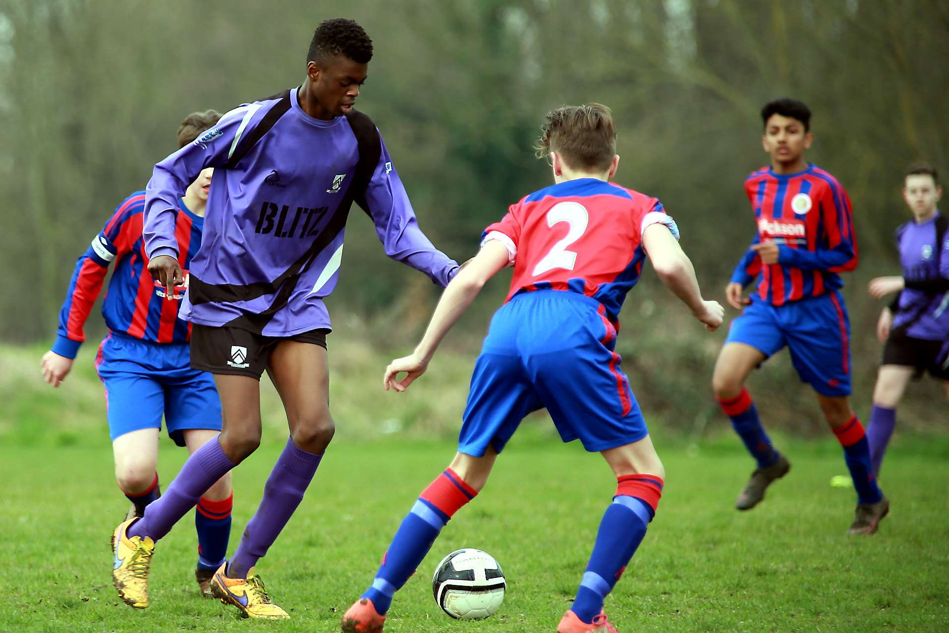 Anchorians under-14s look to find a way past Woodpecker Hi Rovers Picture: Phil Lee