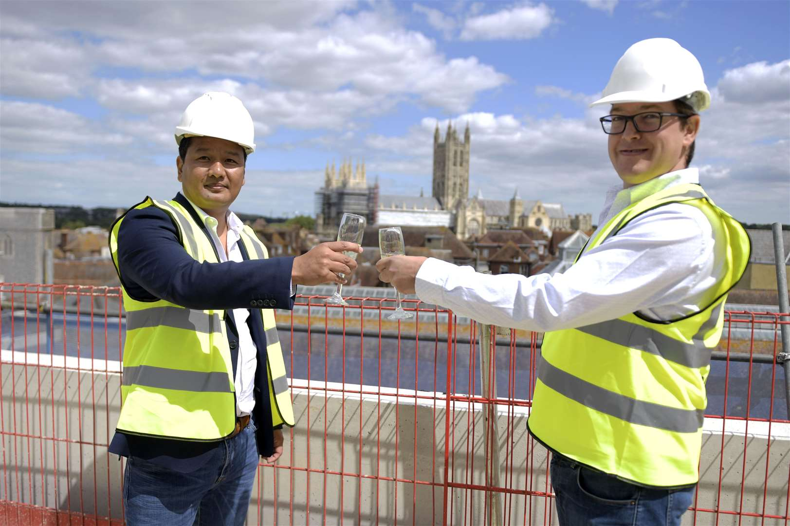 Co-directors of Slatters Development Ltd Zaw Htut and Mike Wood celebrate the topping out ceremony with champagne