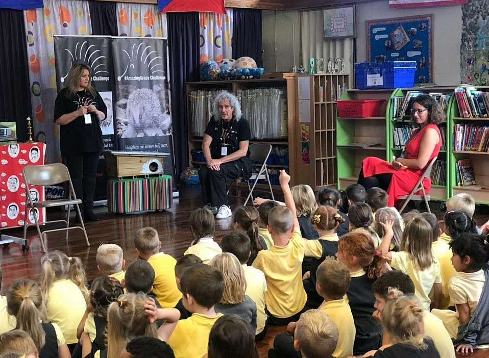 Brian May speaks to children at Year 1 and Year 2 children at Ditton Infant School