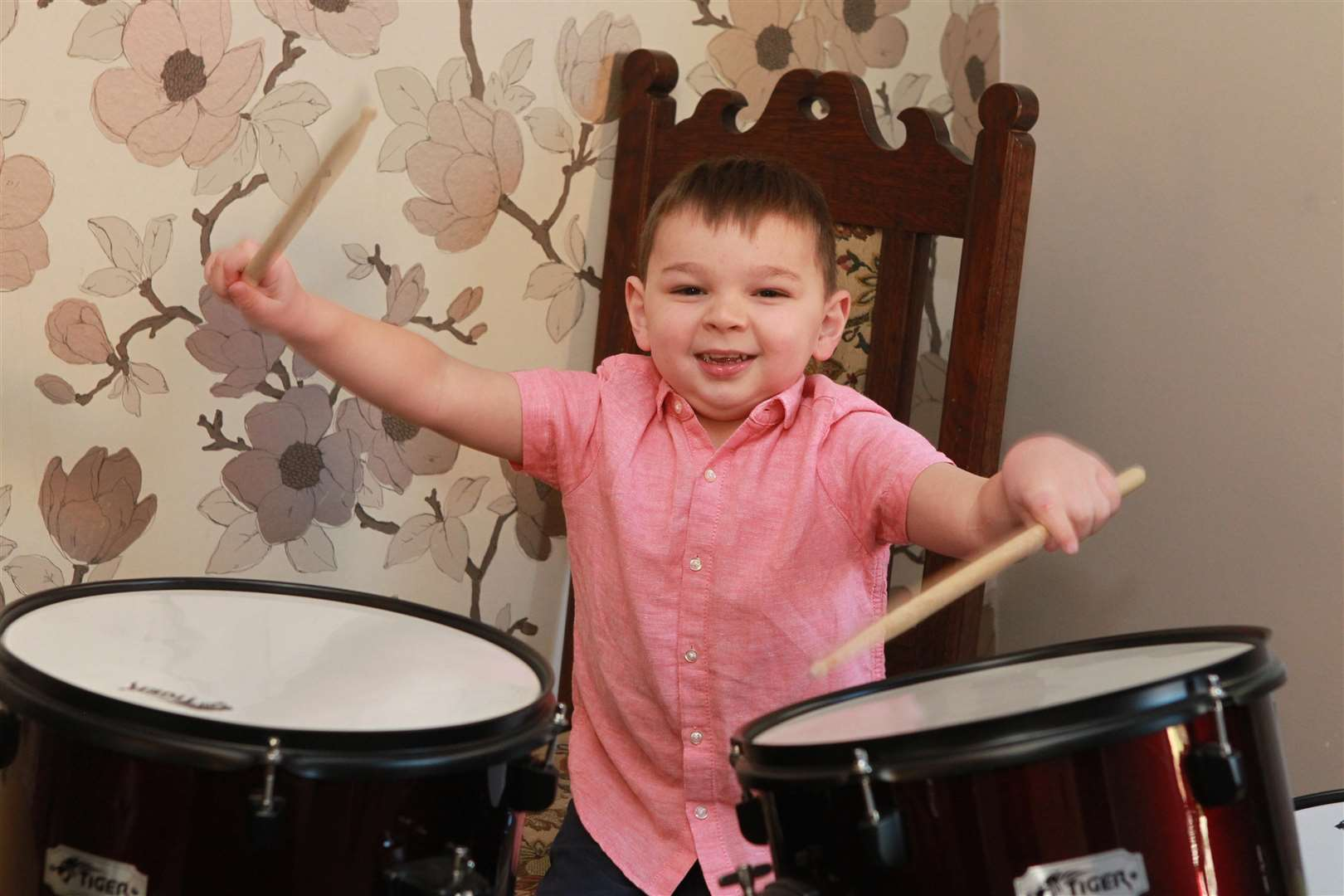 Tony Hudgell, four, playing drums. Picture: John Westhrop