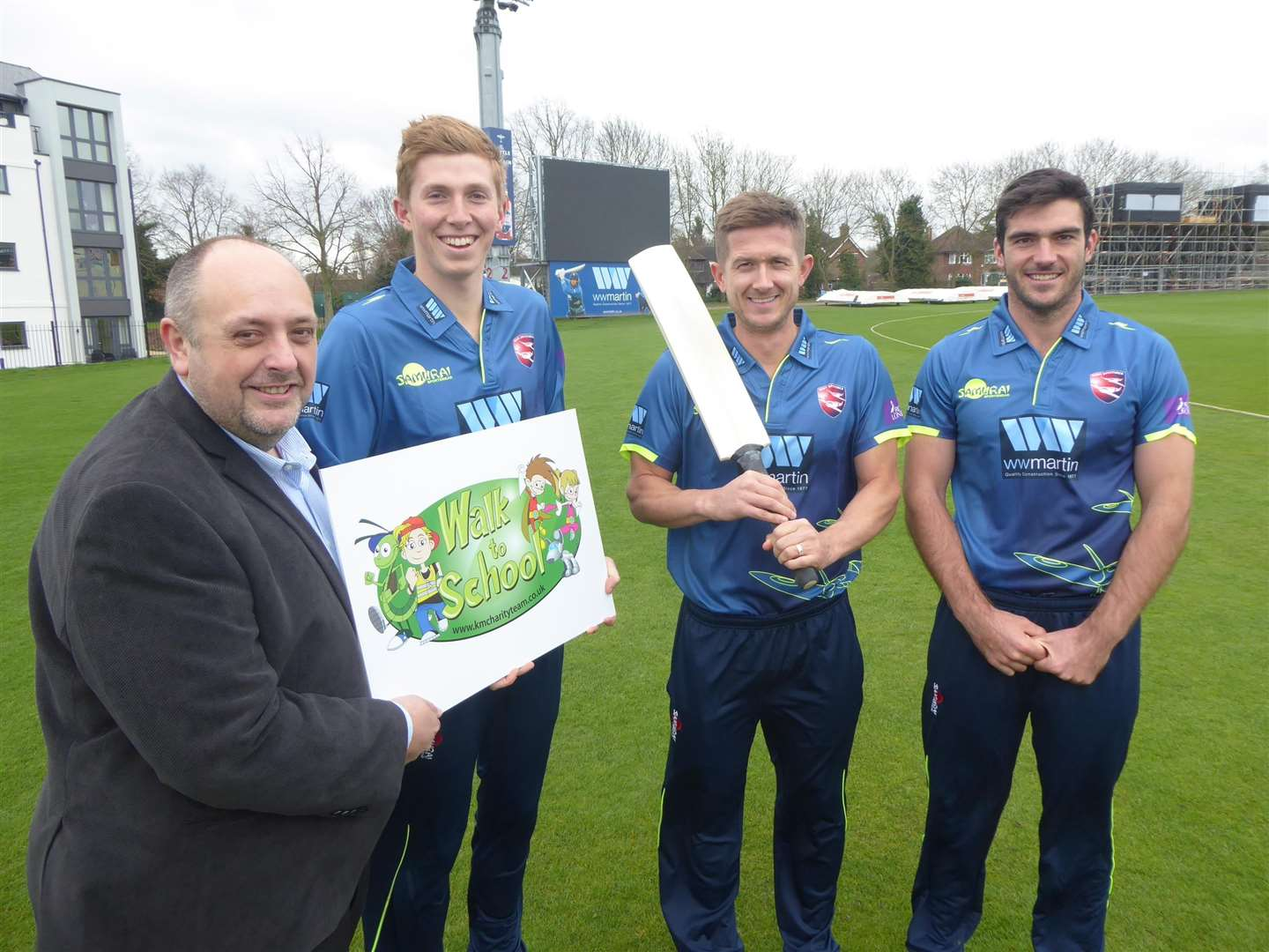 Neil Peck, director of WW Martin, joins Kent cricketers Zak Crawley, Joe Denly and Grant Stewart to promote the walk to school campaign. (1500363)