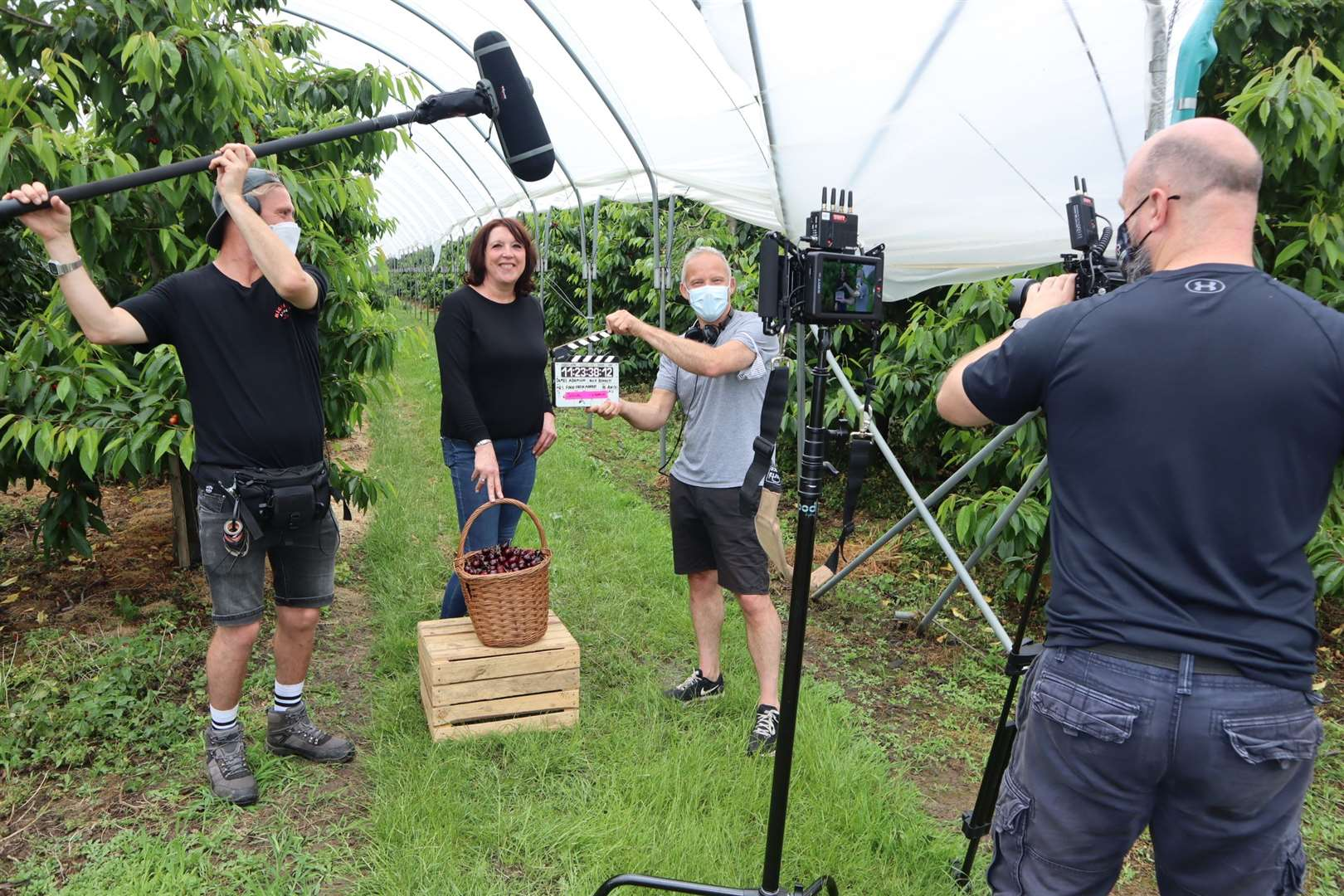 Sarah Neaves, Cherry Farmer from Sittingbourne at Little Sharsted Farm with the ITV film crew for M&S commercial with sound operator Jay Barnett, screenwriter Anton Ezer and cameraman Rich Bennett.  Photo: John Nurden