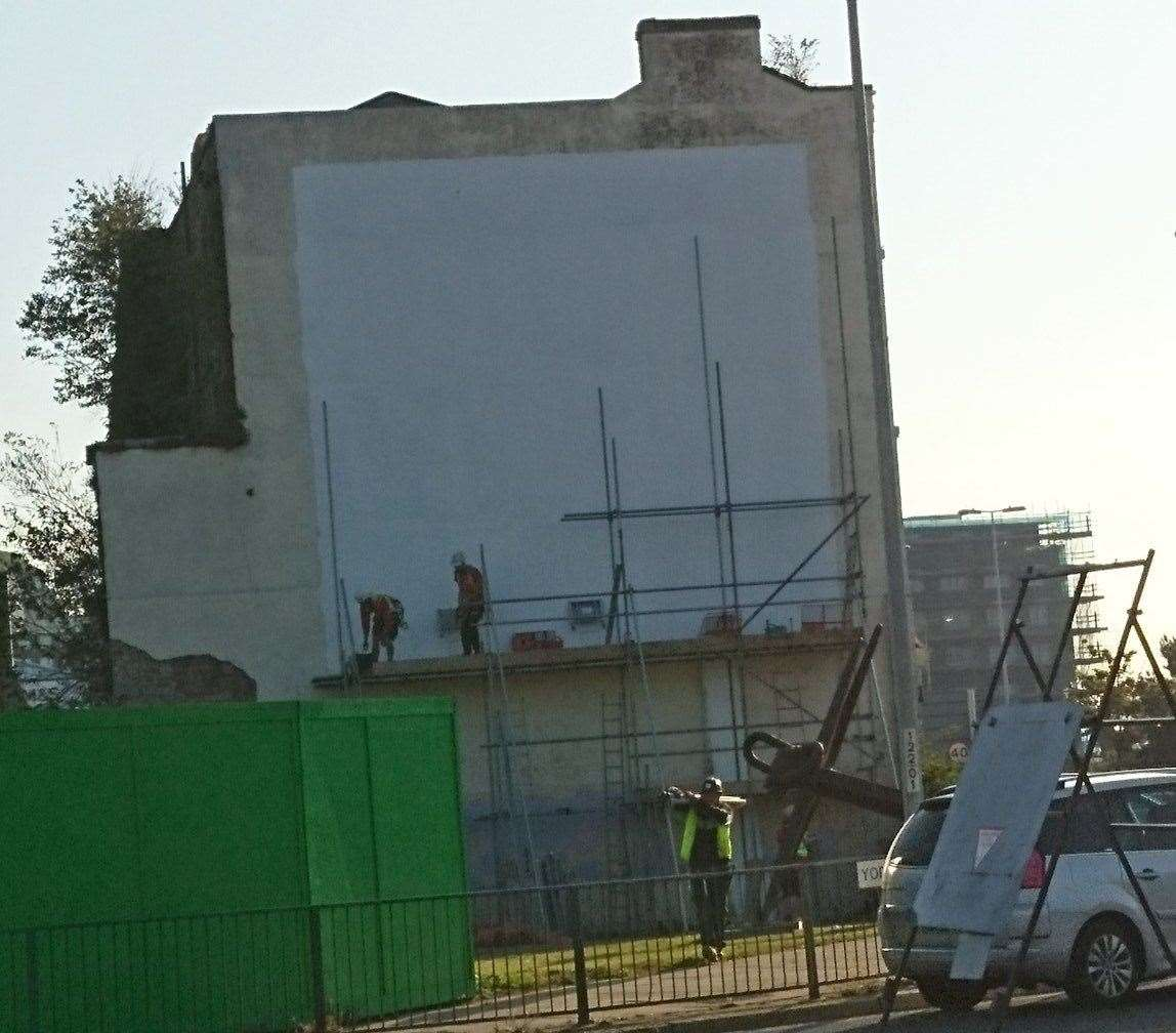 Workmen remove the scaffolding, as this tweet image just before 9am shows. Picture: @Hironius