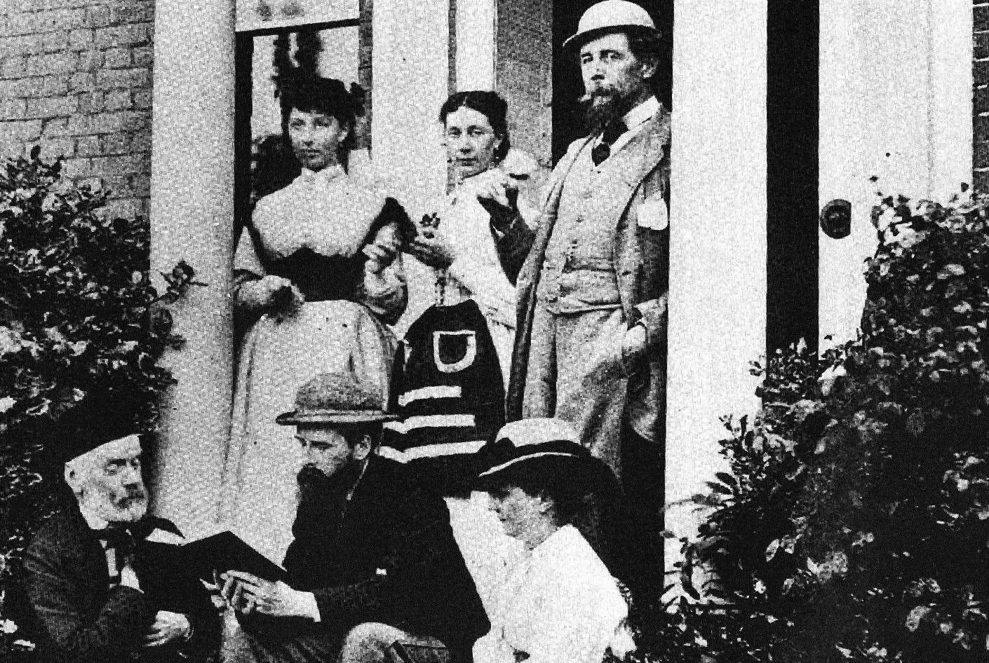 Charles Dickens, far right, in front of his Higham home - today it is Gad's Hill public school. Picture: Gad's Hill School