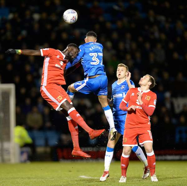 Gillingham's Navid Nasseri against MK Dons' Ousseynou Cisse Picture: Ady Kerry (1341582)
