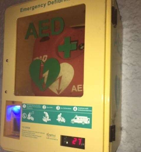 The defibrillator sits on an outside wall of the pub and is protected by the roof of Dell's Dog House
