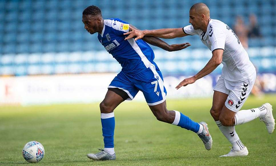 Gillingham striker Brandon Hanlan gets away from his man Picture: Ady Kerry (14058441)