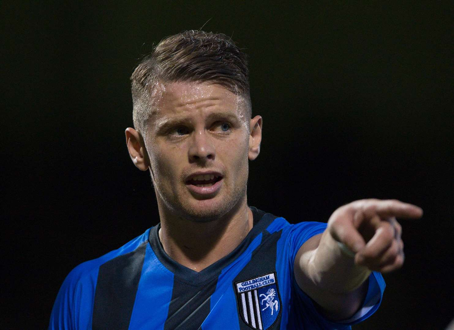 Gillingham's Mark Byrne points the way forward. Picture: Ady Kerry