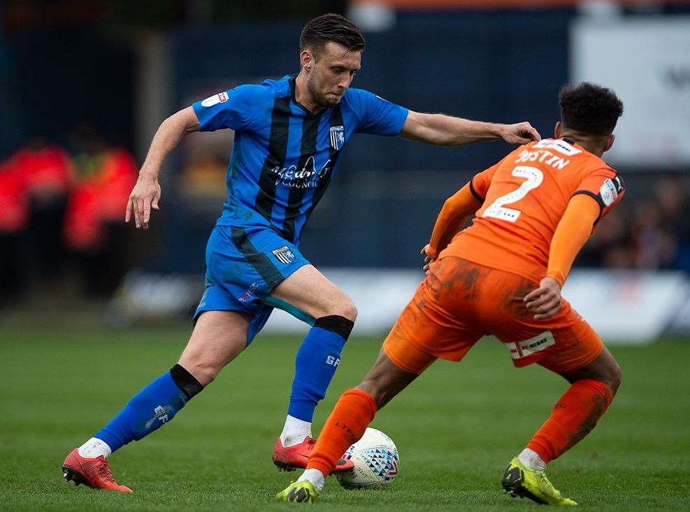 Luke O'Neill takes on Luton left-back James Justin Picture: Ady Kerry