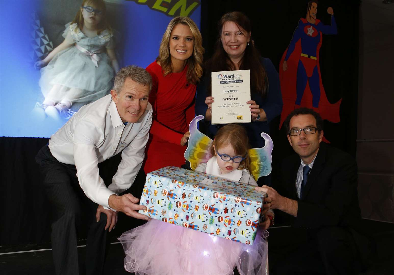 Lucy Bowen winner of Triumph Over Adversity for children aged 6-16 years old with Managing Director for West Kent Lee Crane (Left) and Charlotte Hawkins