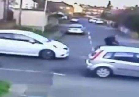CCTV shows a white car approach cyclist Skye Finley before the collision