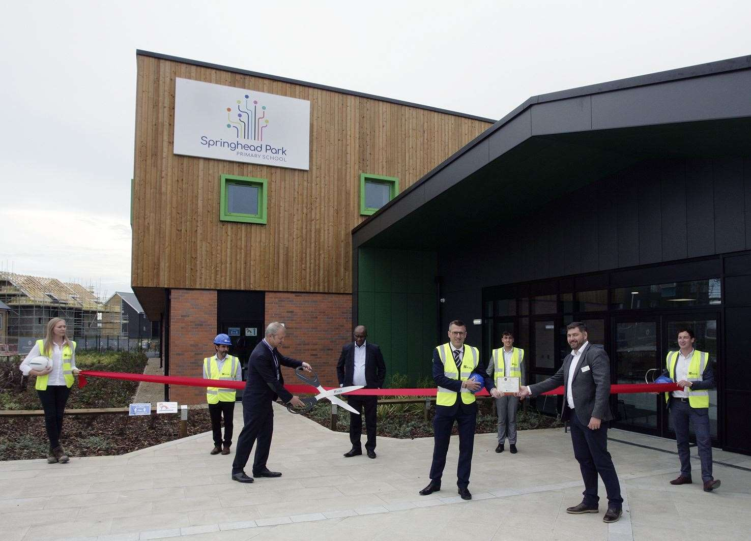Contractors Kier and principal Wayne Clayton cut the ribbon at the grand opening of Springhead Primary School