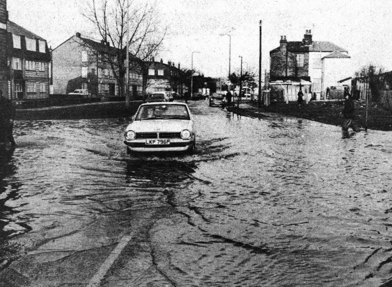 A car aquaplanes in Granville Road when the sea flooded Sheerness in January 1978. KM Photographer.