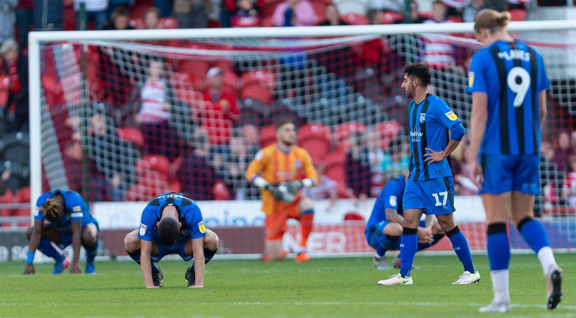 Gills players are left deflated after conceding an injury-time equaliser at Doncaster. Picture: Ady Kerry