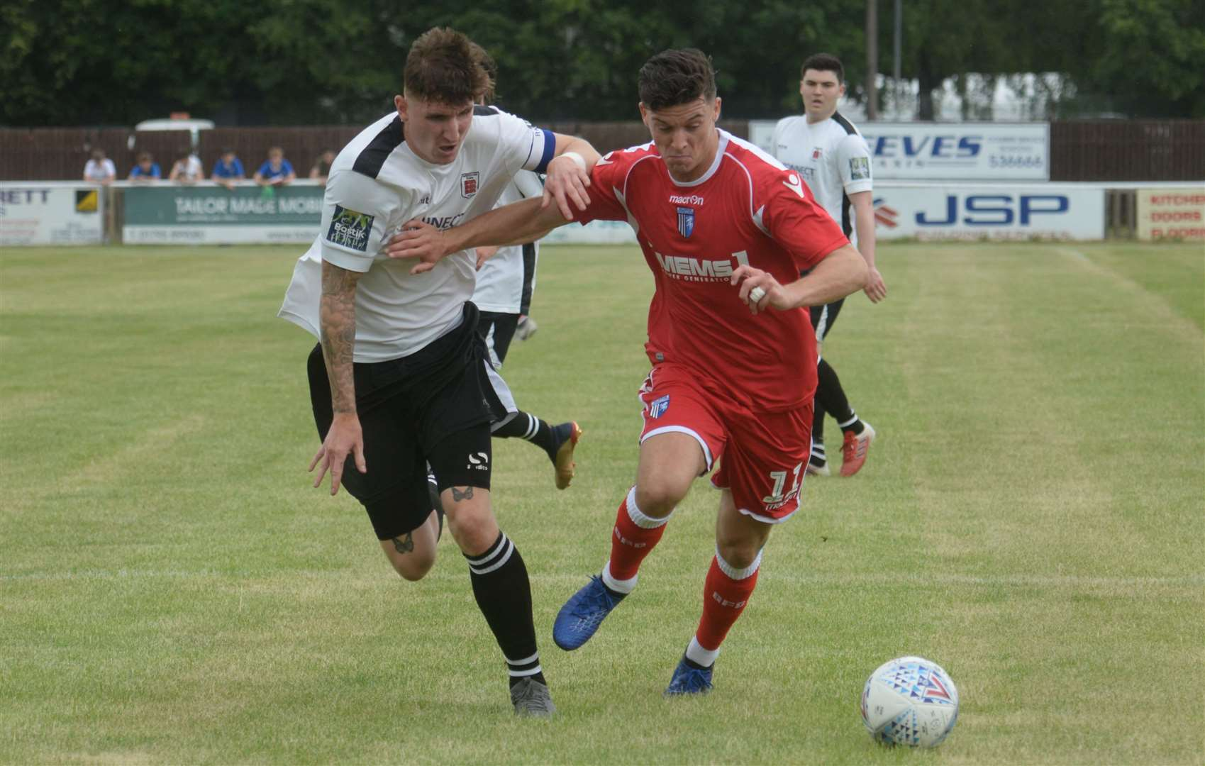 Callum Reilly takes on Faversham captain and former Gillingham player Ryan Huckle Picture: Chris Davey