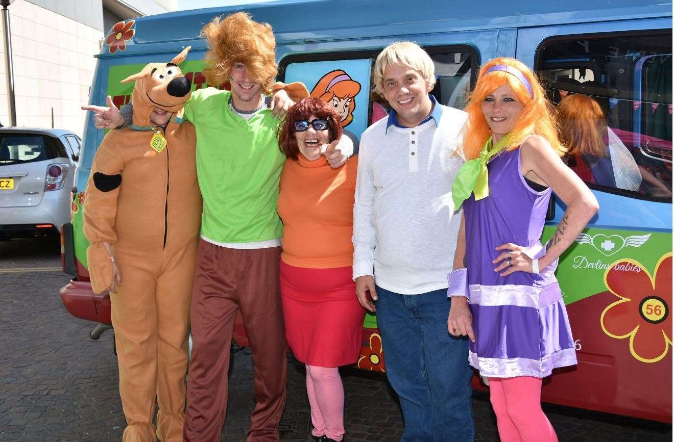 Natalie King (R) and her family travel in the iconic Mystery Inc van to raise money and awareness for infant death