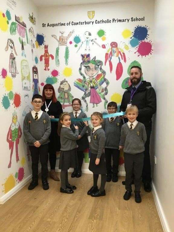 St Augustine of Canterbury Catholic Primary teacher Louise Prestidge and pupils with James Sutton of Medway Council at the unveiling of the school's new superhero mural (23154766)