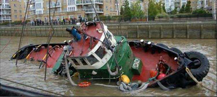 The Chiefton capsized near Greenwich Pier in the River Thames in August 2011. Picture: MAIB