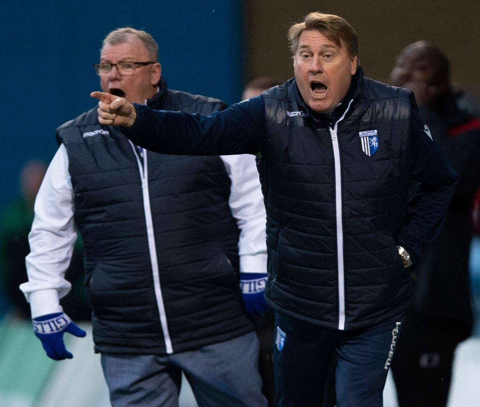 Assistant boss Paul Raynor and manager Steve Evans roar Gills on against Doncaster Picture: Ady Kerry