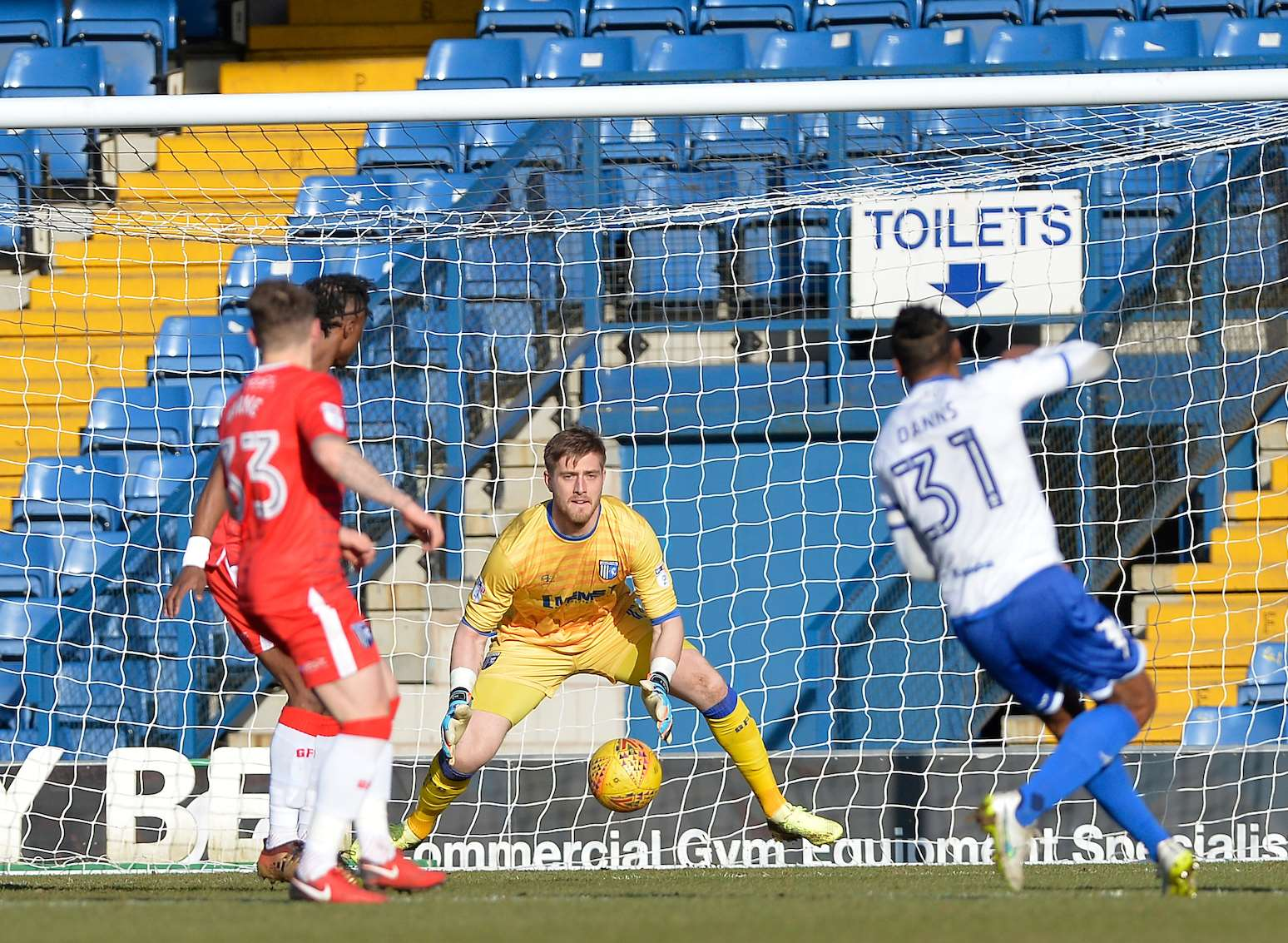 Neil Danns opens the scoring for Bury, beating Tomas Holy from outside the box Picture: Ady Kerry