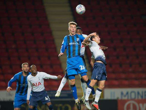 Gillingham's Kack Tucker jumps for the ball Picture: Ady Kerry (4704999)