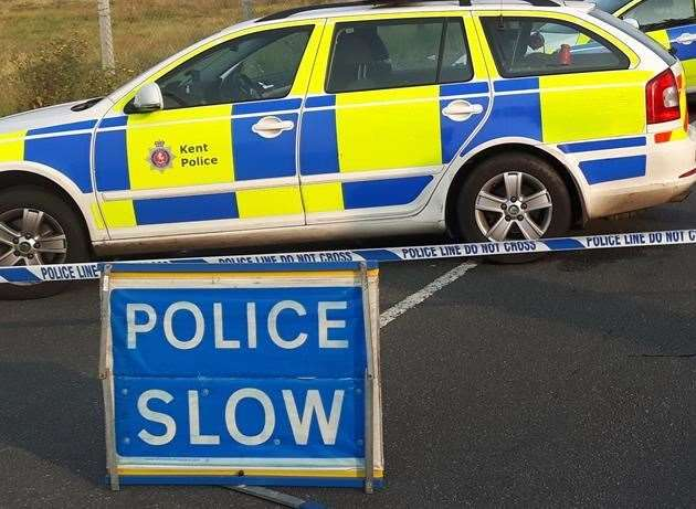 Kent police car and slow sign. Stock photo (9529985)