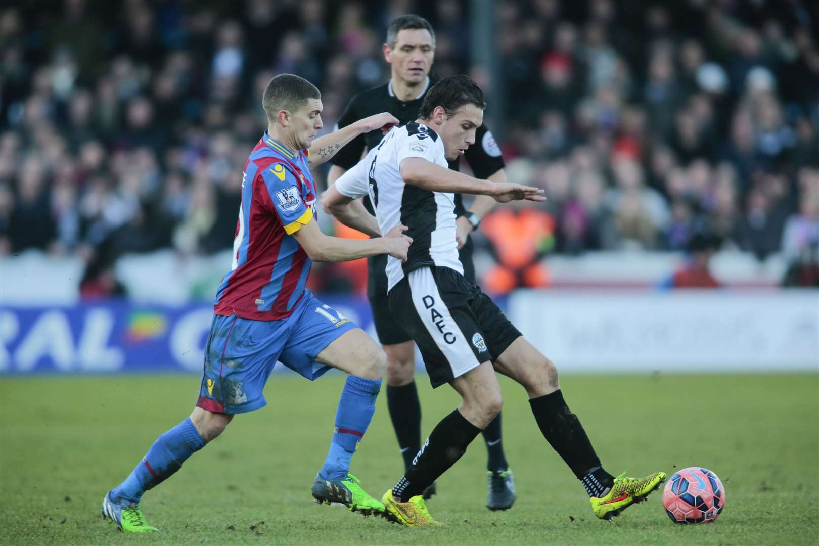 Stuart O'Keefe pressures Dover's Liam Bellamy while playing for Crystal Palace in the FA Cup Picture: Martin Apps