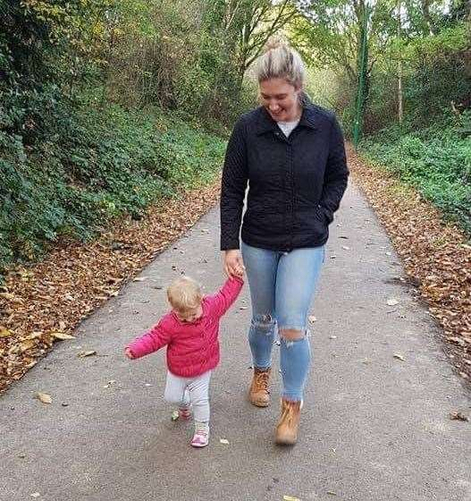 Hannah walks along the path with daughter Isabelle