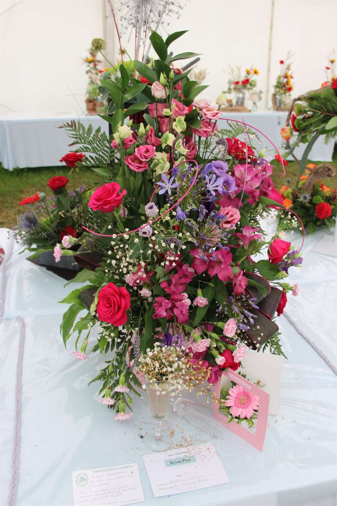 "Nicola Prior, who runs Nic's Restaurant in Queenborough, came second in the Kent County Show flower competition 'Birthday Party' category. Judge Chris Brown said it was a ""good interpretation of the title and suitable use of accessories."" (13545735)"