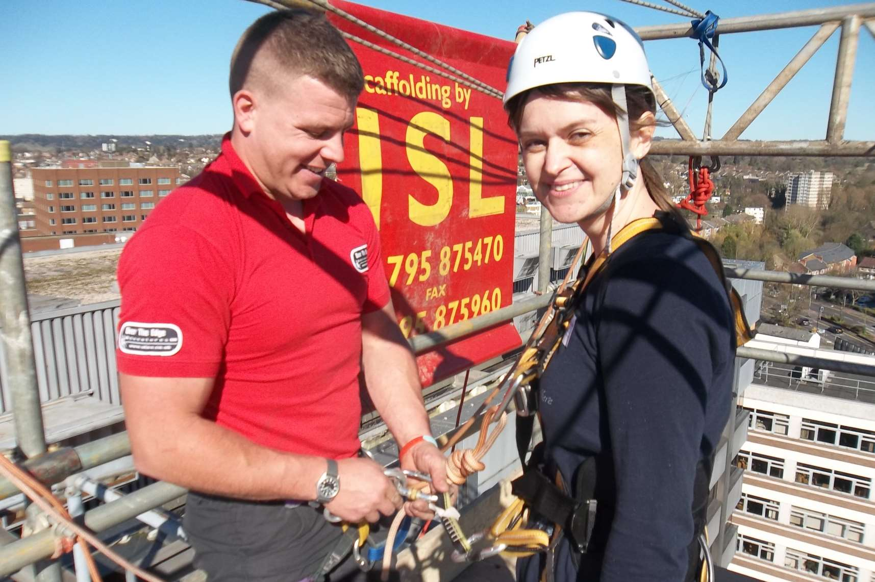 Ann-Marie Langley of Maidstone from event sponsor DSH being briefed by abseil instructor Joe Lovelock.
