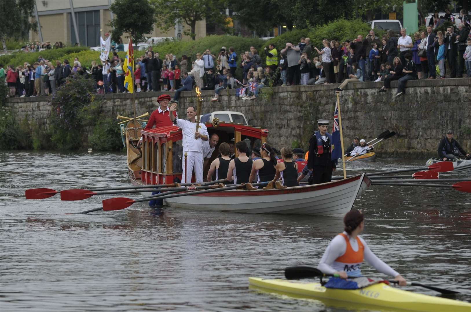 David Boyle from Tonbridge with the torch on the River Medway at Maidstone