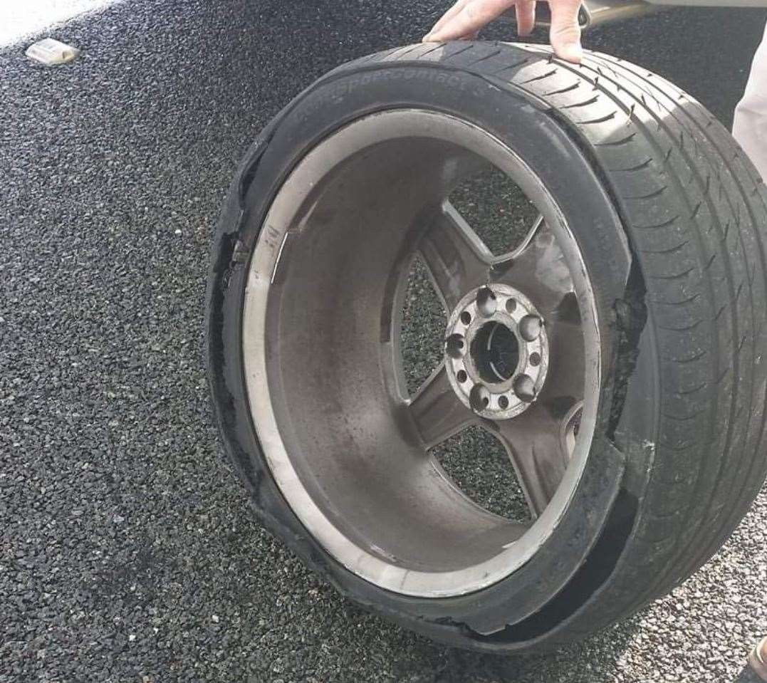 The shredded tyre which the couple say was 'spiked' at a service station