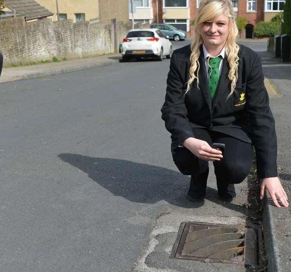 Ella Birchenough at the storm drain. Picture: SWNS
