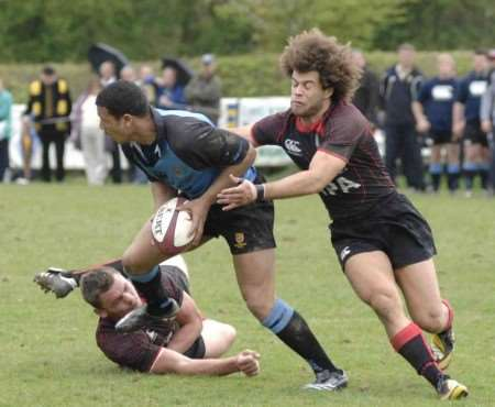 Canterbury (blue) look to go on the offensive against Blackheath