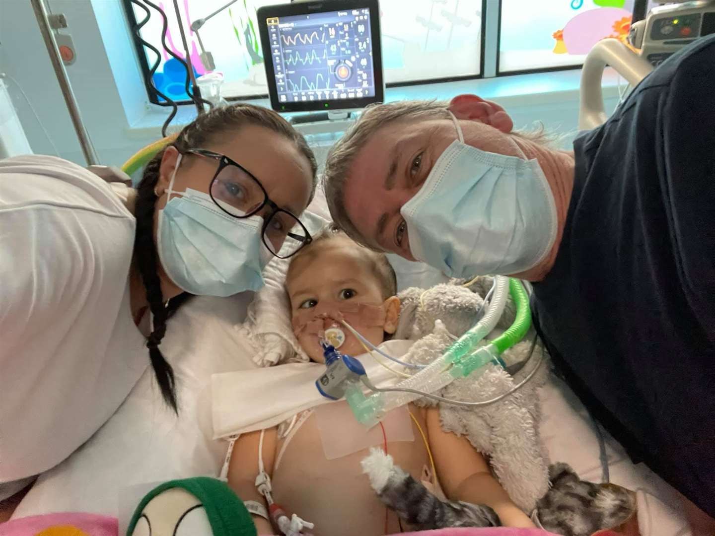 Lauren and Colin with Izzy before her surgery. Photo: Isobel's Army Facebook Page