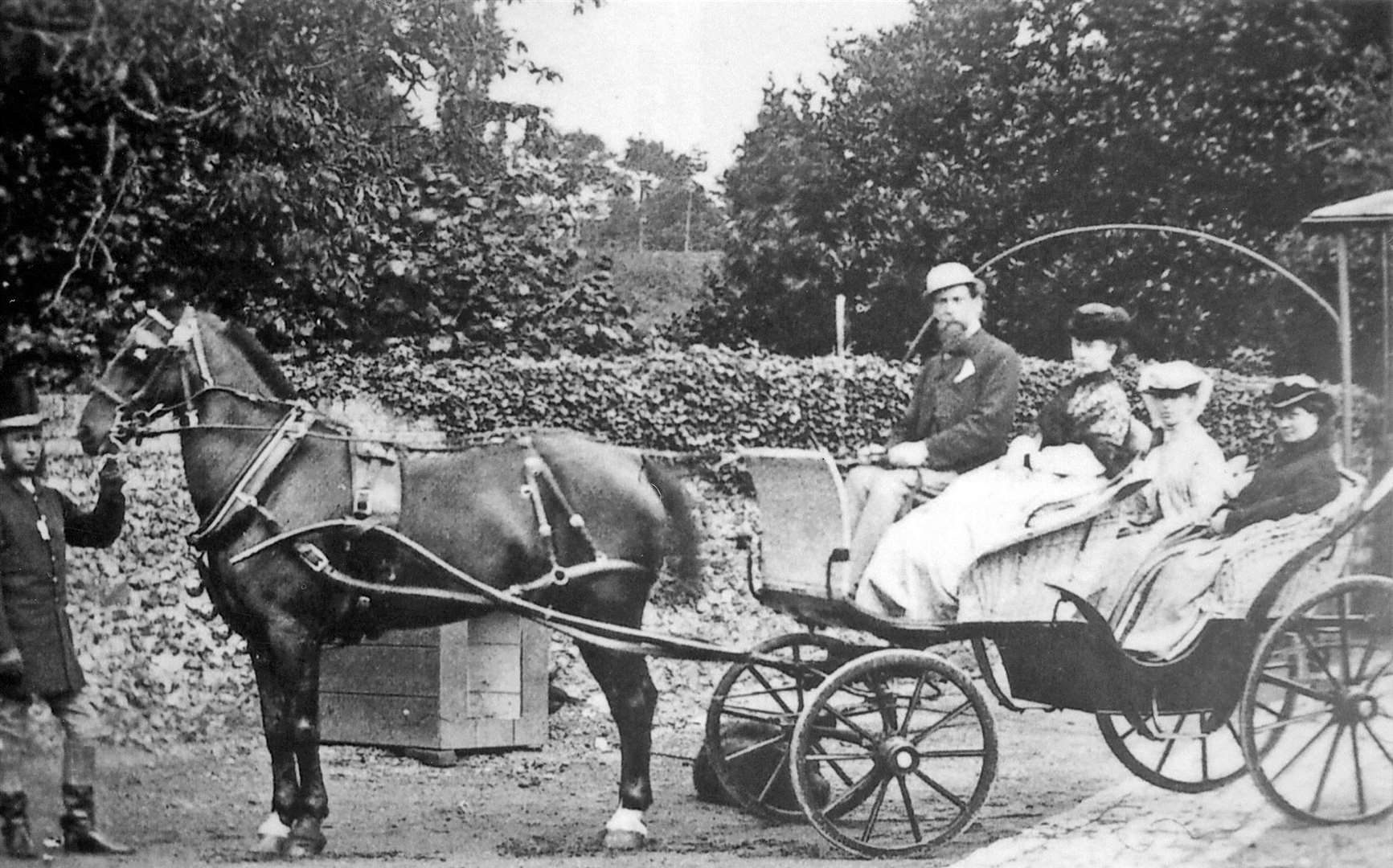 "Charles Dickens and his family in a carriage at their home in Higham. At the horse's head is groom John Marsh, who foiled an attempt to cause ""serious mischief"" to the vehicle"