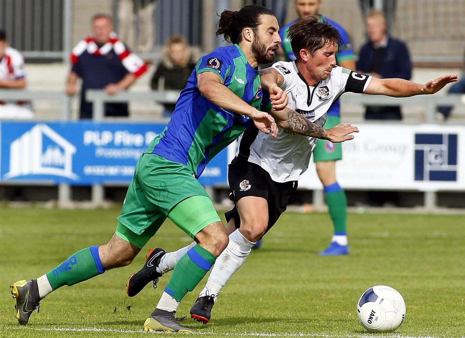 Dartford's Lee Noble holds off Dorking Wanderers' Daniel Gallagher. Picture: Sean Aidan