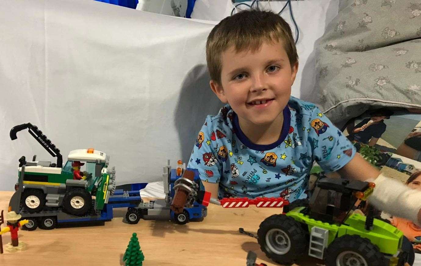 Joe Ward-Bates with Lego sets he proudly built while being treated at King's College Hospital