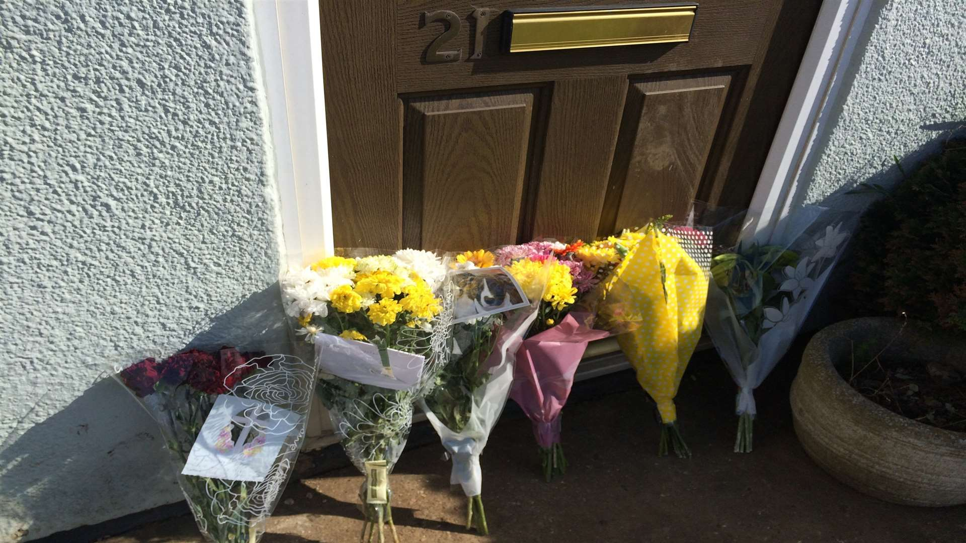 Floral tributes left after Carlo Collins died