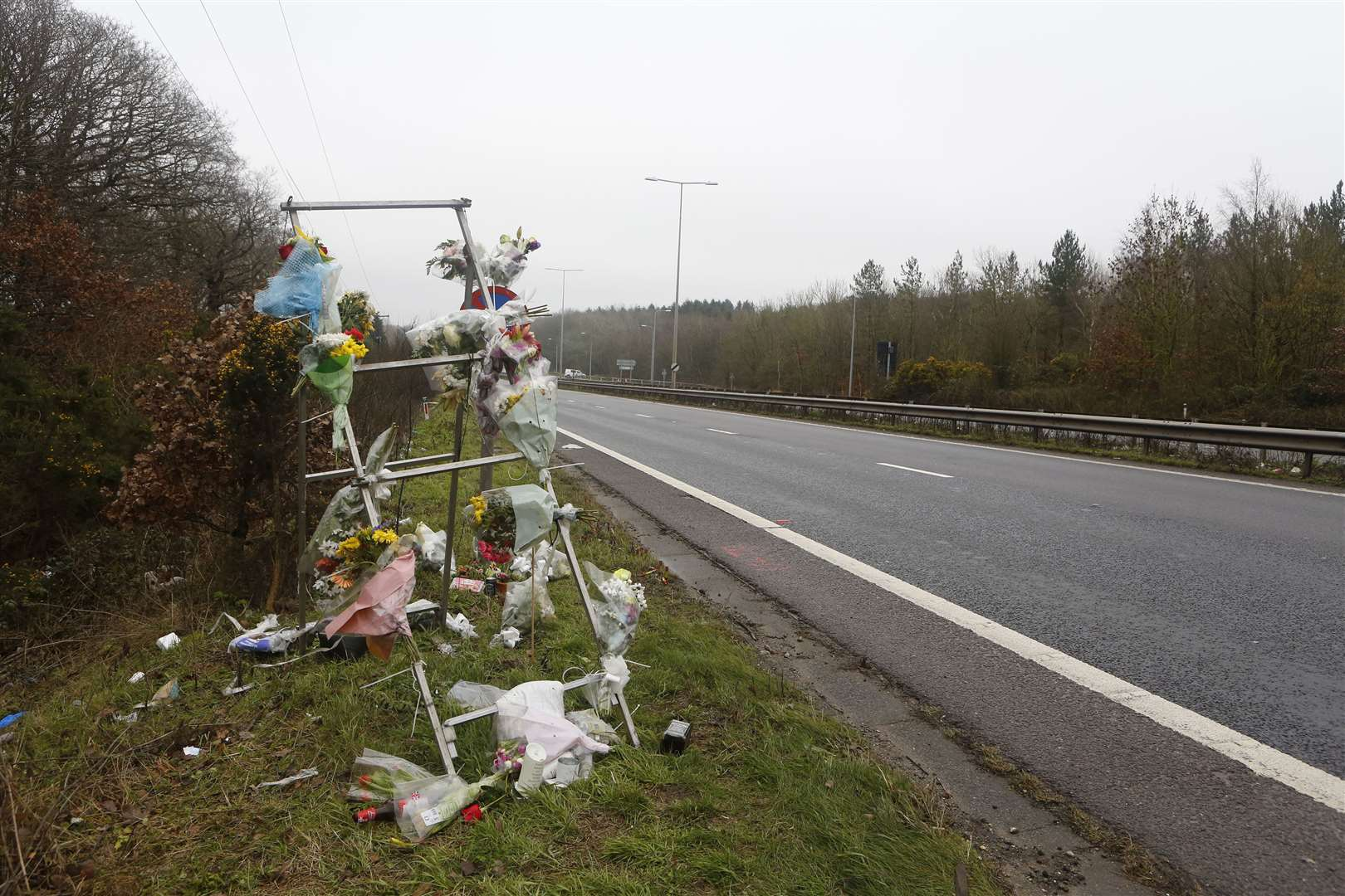 Flowers and tributes left at the scene of the fatal crash