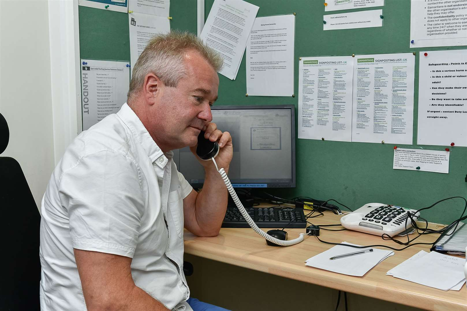 Samaritans Charity Director, Des McCarthy, on the telephone at The Samaritans offices in Strood. Picture: Tony Jones (15193623)