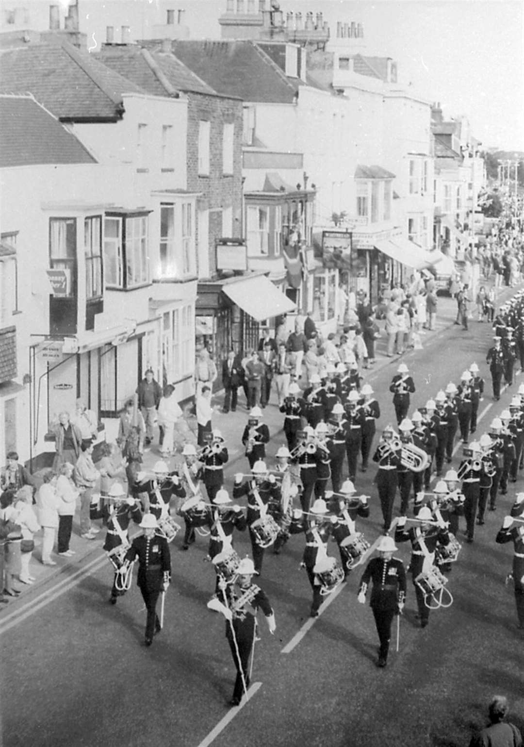 Townpeople watched as the band marched through the streets of Deal leaving empty spaces for those killed
