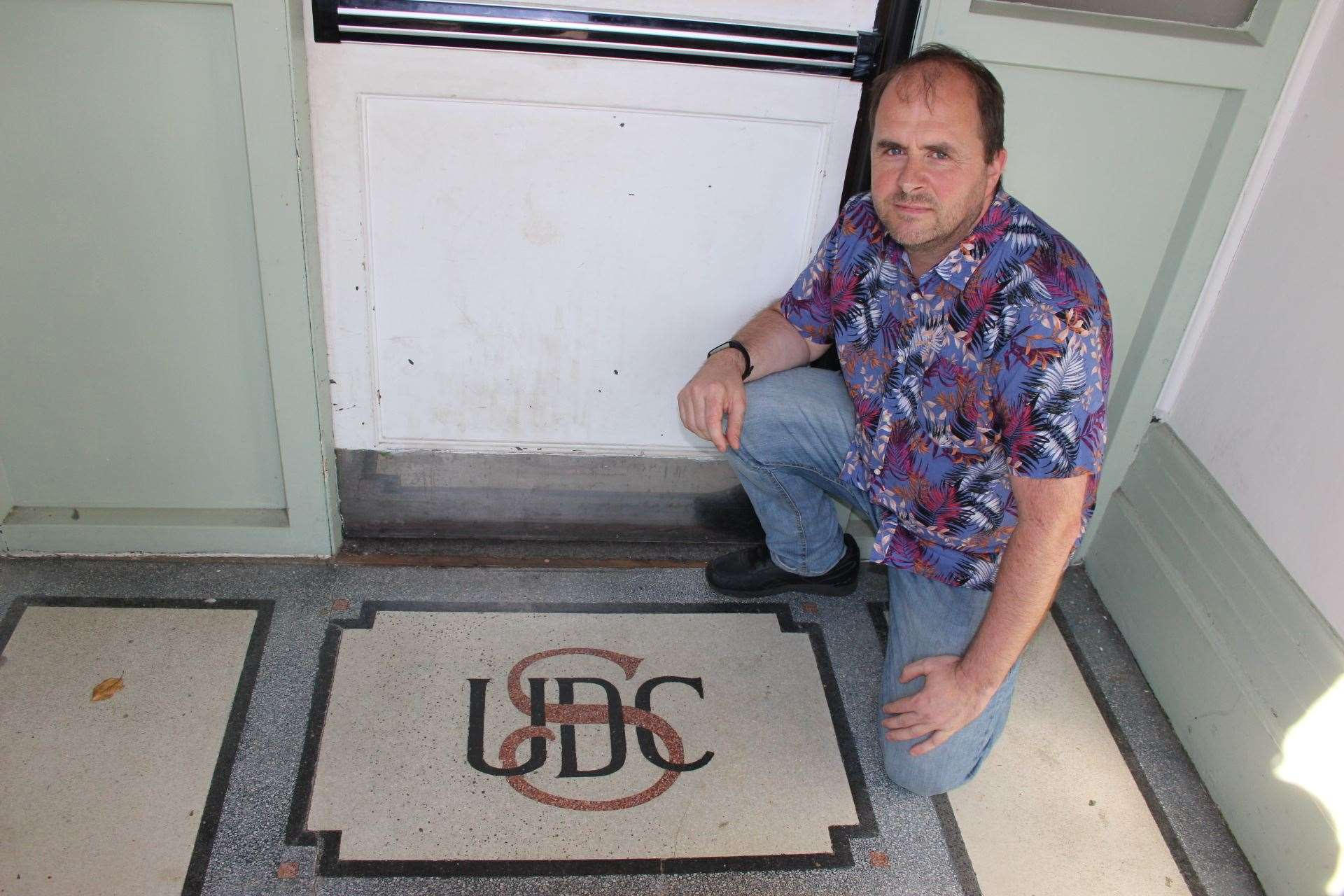 Chris Foulds of Sheerness Town Council with the old Sherness Urban District Council floor mosaic (15153532)